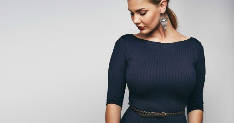 Woman in black close fitting dress
