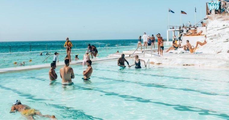 People in swimming pool near the sea