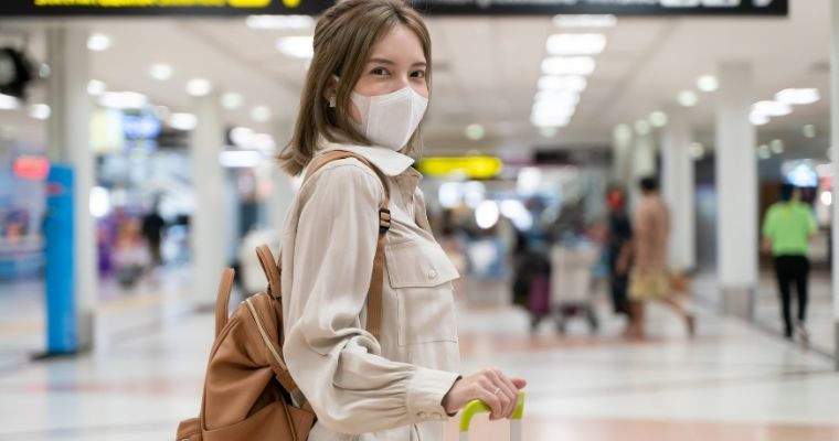 Woman at airport wearing a mask