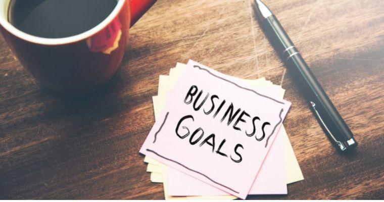Business goals written on a piece of paper