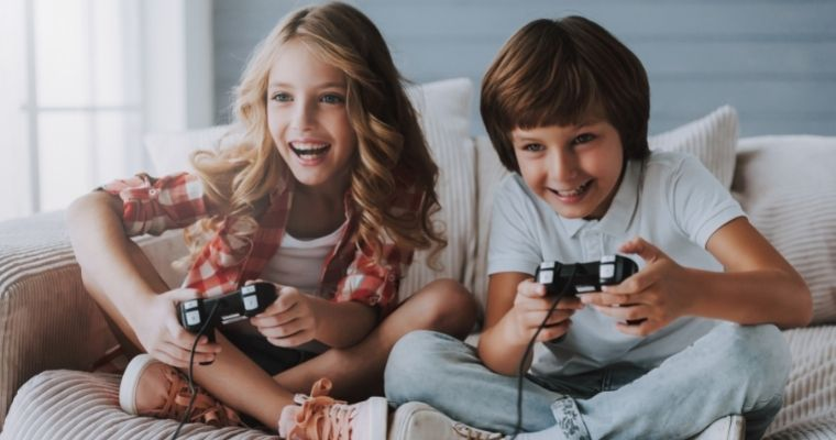 Girl and boy playing video games