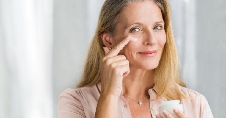 Woman applying anti-ageing cream