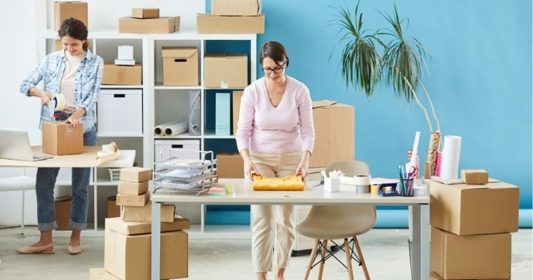 Women working, packing items