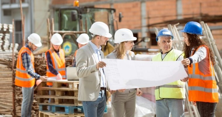 Construction workers looking at a building plan