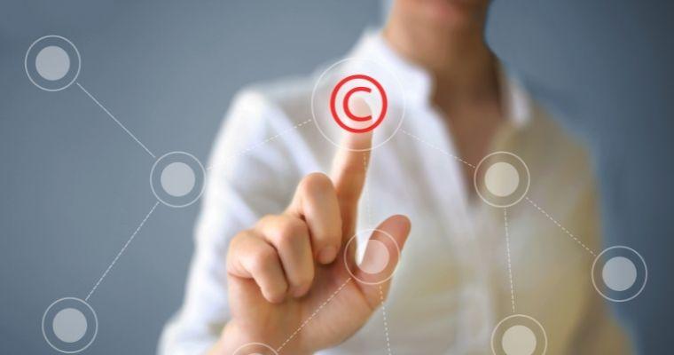 Woman pointing at a copyright symbol