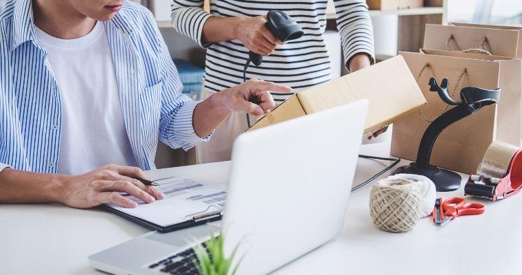 two people preparing online orders