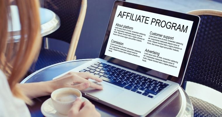 A woman on a laptop reading about an affiliate platform