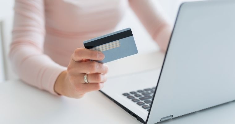 A woman paying for something online